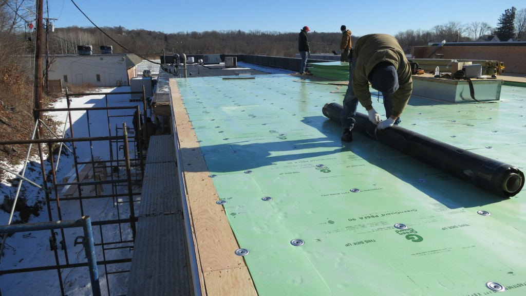 New rubber roof installation