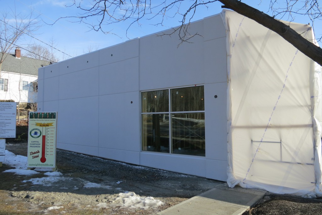 Exterior Insulation Finishing System (EFIS) and aluminum storefront window installation
